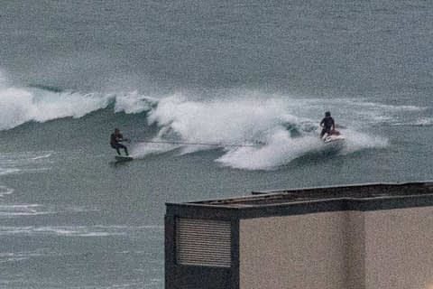 tow in surfers